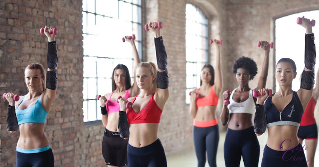 women-exercise-with-weights-for-strength-training
